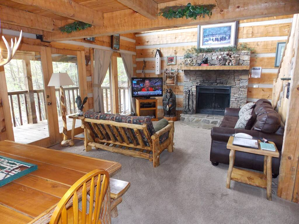 Wooden cabin livingroom with fireplace